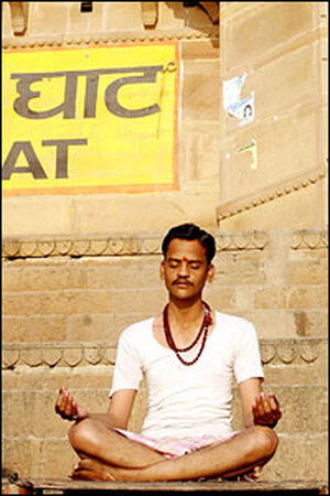 In Varanasi, one of Hinduism's holiest cities, a man meditates in the early morning