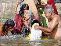 Hindu pilgrims bathe in the holy waters of the Ganges at Varanasi