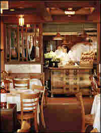 The dining room at Chez Panisse offers a view of the kitchen.