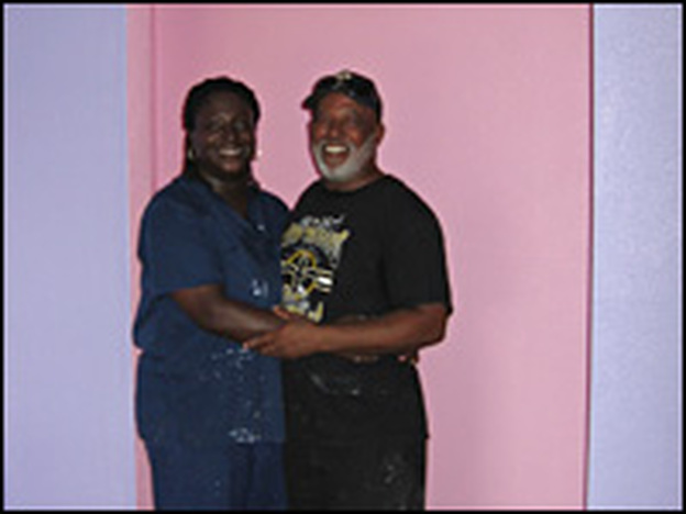 Yolanda and Antoine Duplessis stand in their daughter's newly-painted bedroom in St. Bernard Parish.  The house was rebuilt by volunteers.