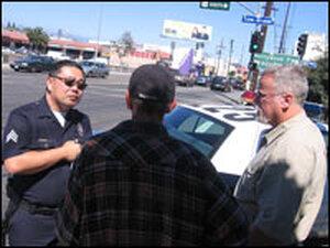 Sgt. Bob McDonald, a mugging victim and Michael Connelly.
