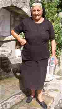 An elderly Greek woman at the village well.