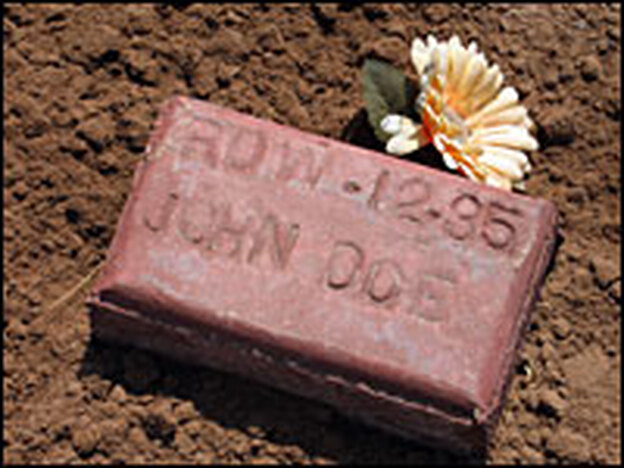 A grave marker in the paupers' section of a cemetery in Holtville, Calif., near the U.S.-Mexico border. Nearly 400 unidentified people, believed to be illegal immigrants, are buried there.