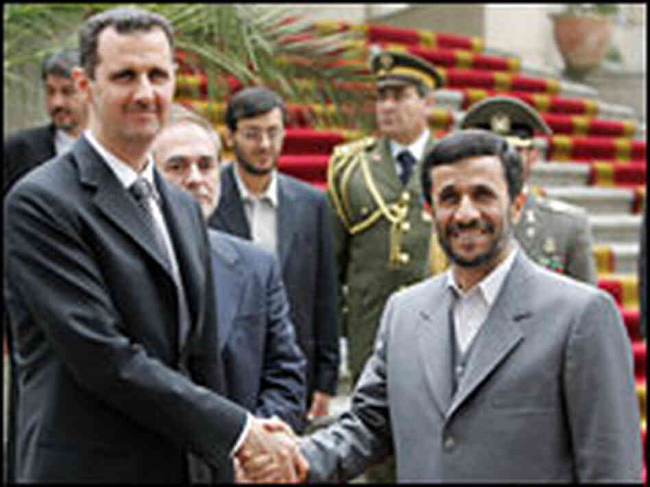 Ahmadinejad greeting al-Assad