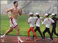 Yao Ming runs around a track in Beijing.