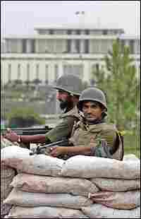 Pakistani paramilitary soldiers stand guard in a bunker in Islamabad.