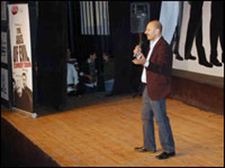 Jobrani performs on stage.