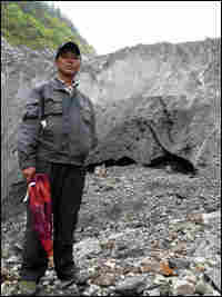 The chief of Mingyong village, Da Zhaxi, stands at the tip of the glacier.