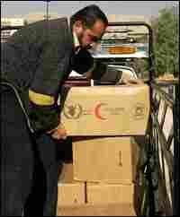 A man unloads food aid for Iraqi refugees at a U.N. center in Damascus.