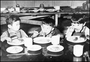 Children eat hot dogs at Idaho's Minidoka Internment Camp.