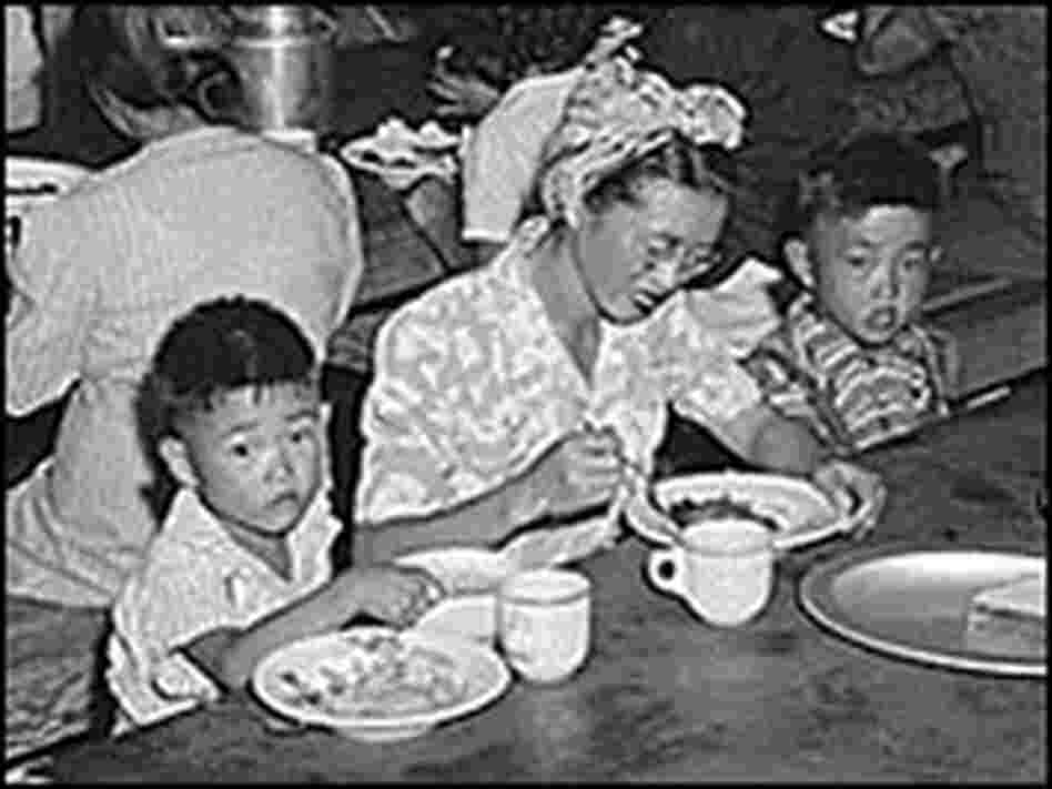 Meal time at a mess hall at the Manzanar internee camp.