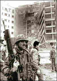 A U.S. Marine stands guard after the U.S. Embassy bombing in Beirut.