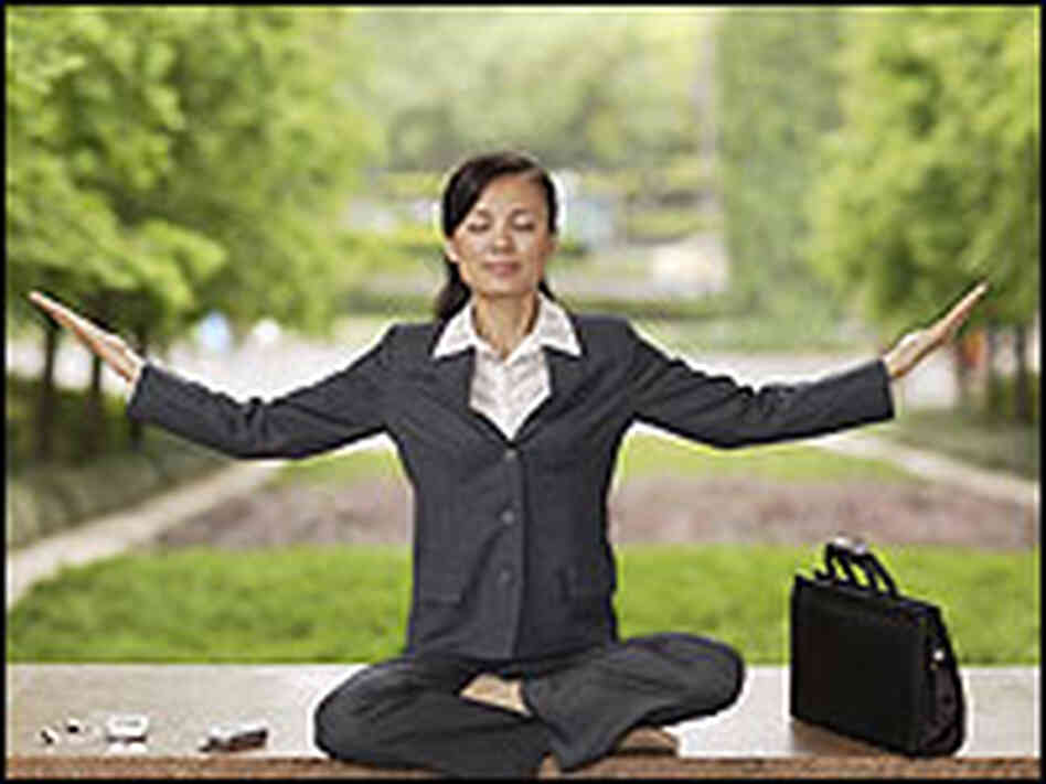 A business woman in a meditation pose.