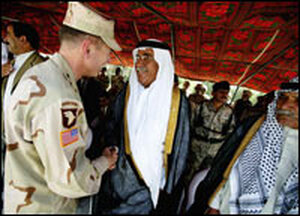 Lt. Gen. David Petraeus (left) meets local dignitaries while he visiting a coalition base in Tikrit.