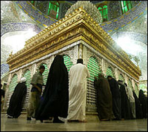 Shia worshipers pray in front of the shrine of Imam Ali bin Abi Talib.