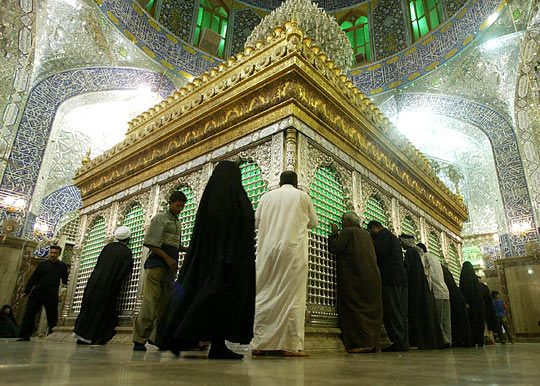 Shias worshipping at the tomb of Ali in Najaf Iraq