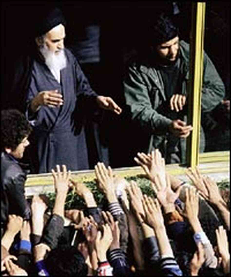 Ayatollah Ruhollah Khomeini is greeted by supporters during his return to Iran in 1979.