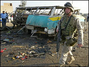 A U.S. soldier patrols the site of an explosion in Baghdad.