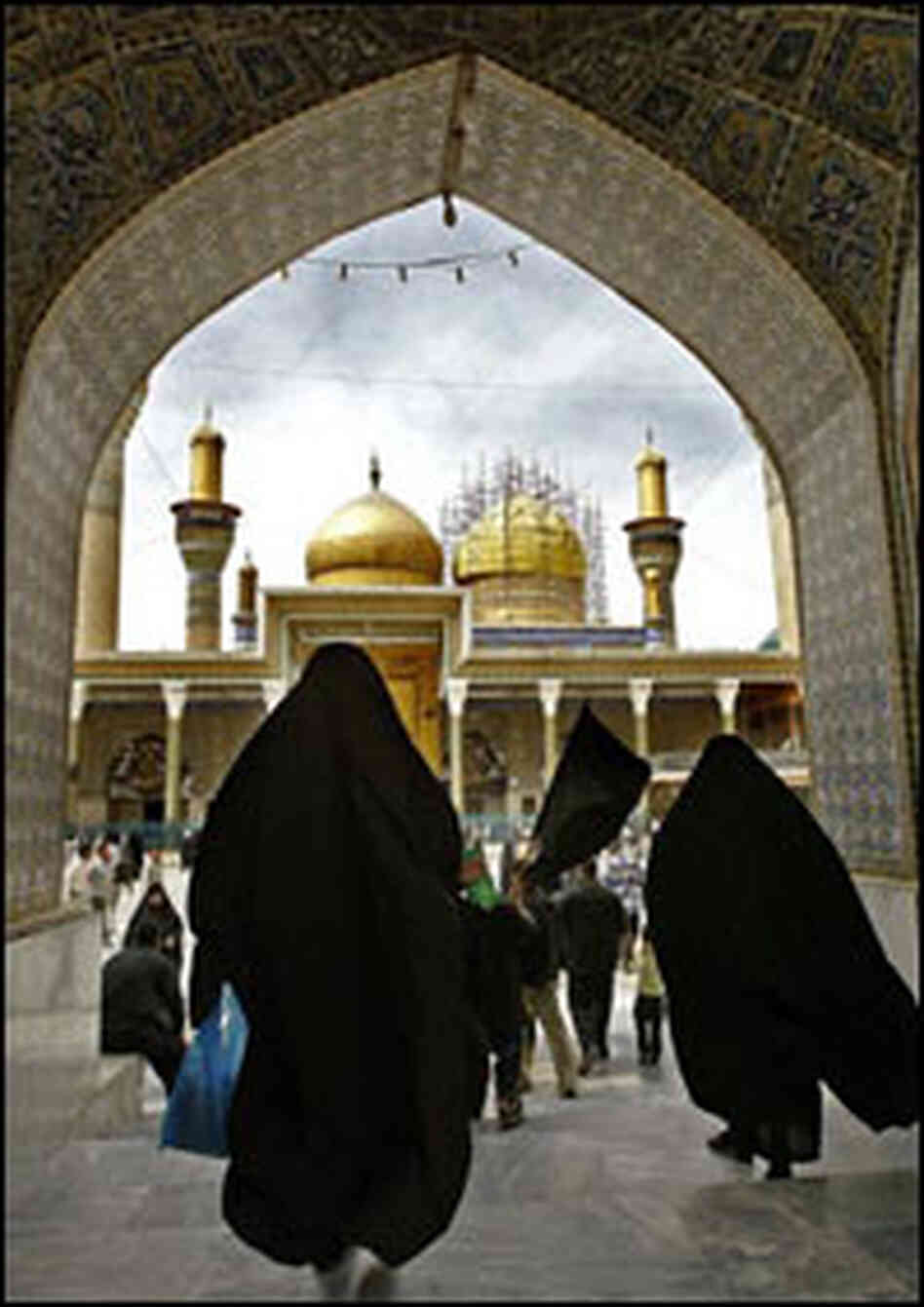 Iraqi women visit the shrine of Imam al-Kazem in Baghdad.