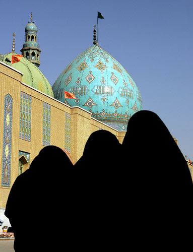 Women walk in the courtyard of the Jamkaran mosque outside the holy city of Qom, Iran.
