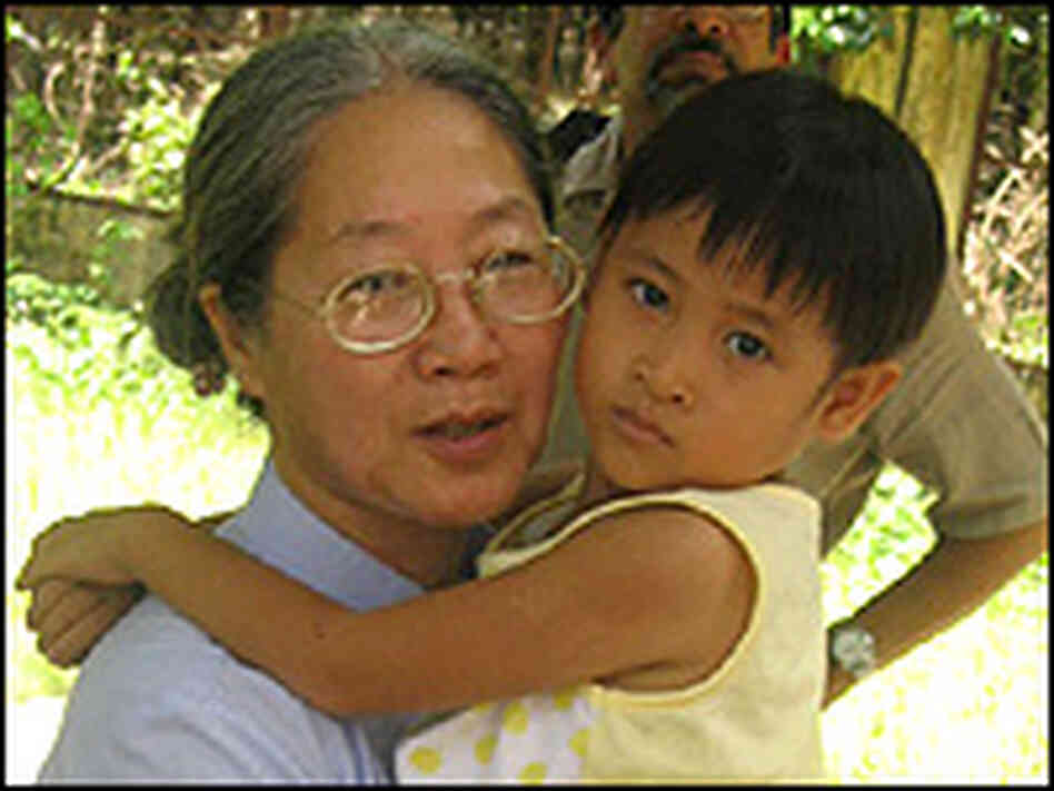 Sister Tue Linh and an AIDS orphan at the Mai Hoa AIDS Center in Cu Chi