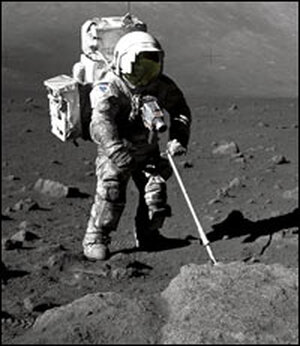 Harrison Schmitt's white space suit was covered in gray lunar dust.