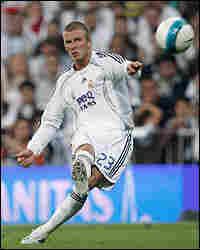 David Beckham takes a free kick.
