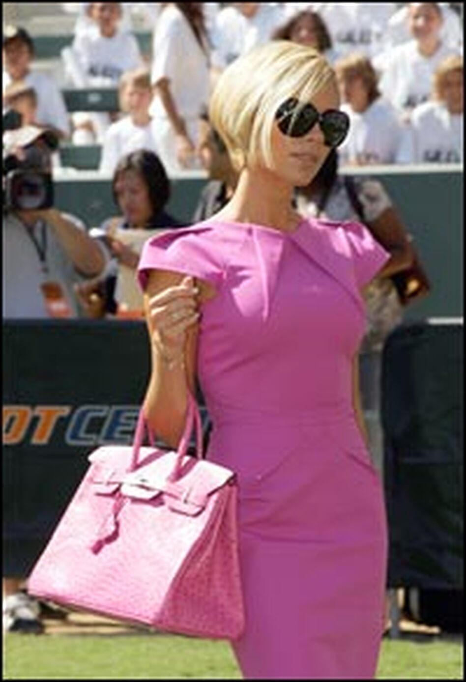 Victoria Beckham keeps the paparazzi busy at the Home Depot Center, July 13, 2007. This week, the former and future Spice Girl introduced herself to America in a show on NBC.