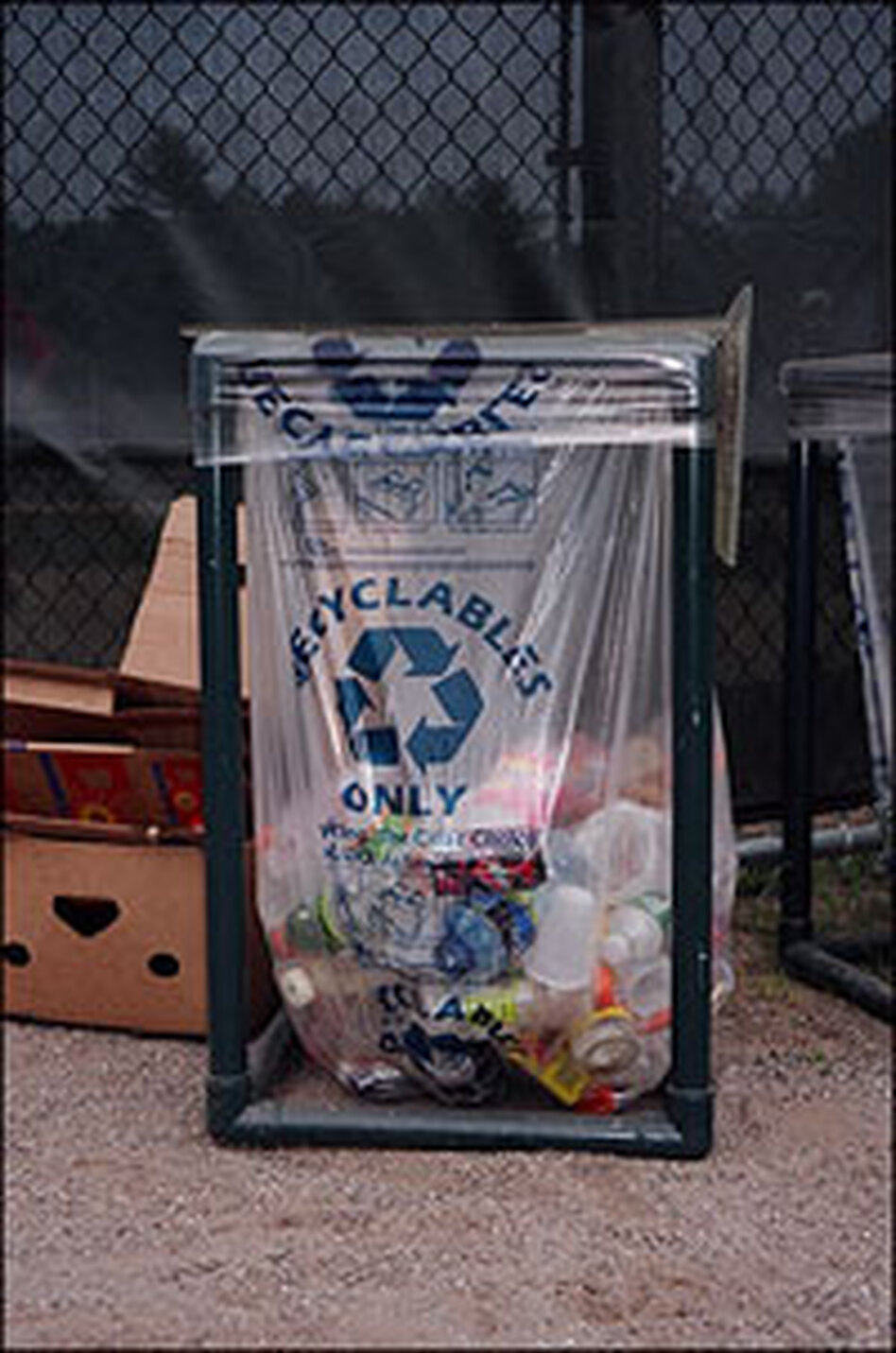 Containers like this one at a Mansfield, Conn., ball field have increased recycling of bottles and cans there by about 60 percent.