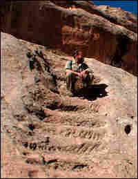 Craig Childs sits on an ancient stairway.