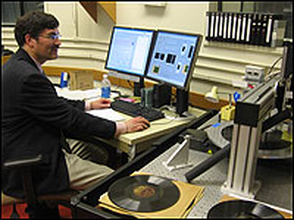 Peter Alyea, a digital conservation specialist at the Library of Congress, scans a record from the 1930s.