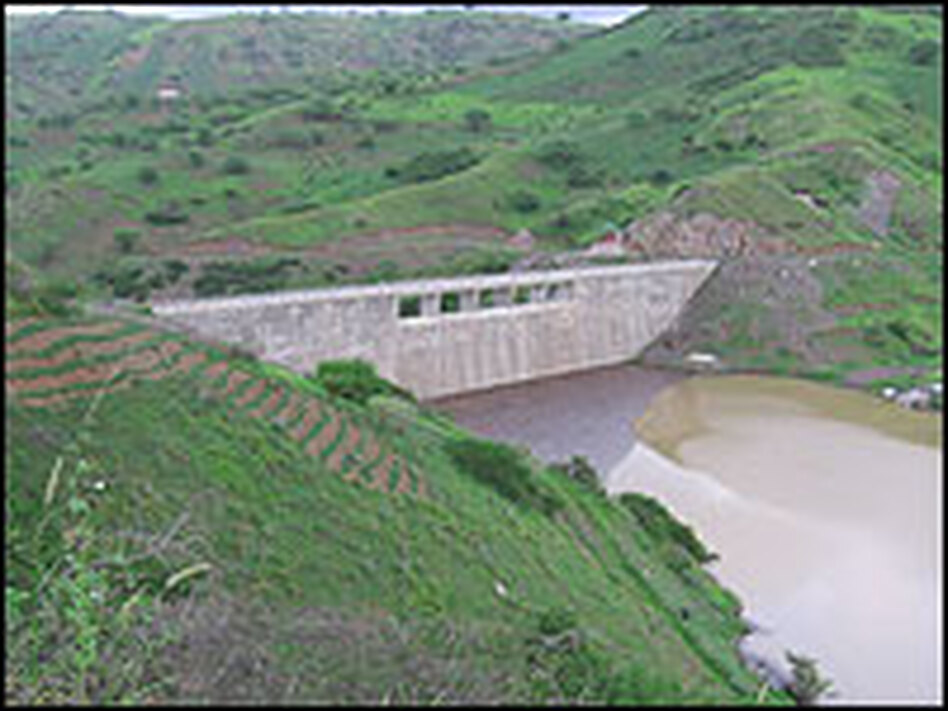 The Poilao dam is part of Santiago's new water system. But after six months, there still hasn't been enough rain to fill its reservoir.