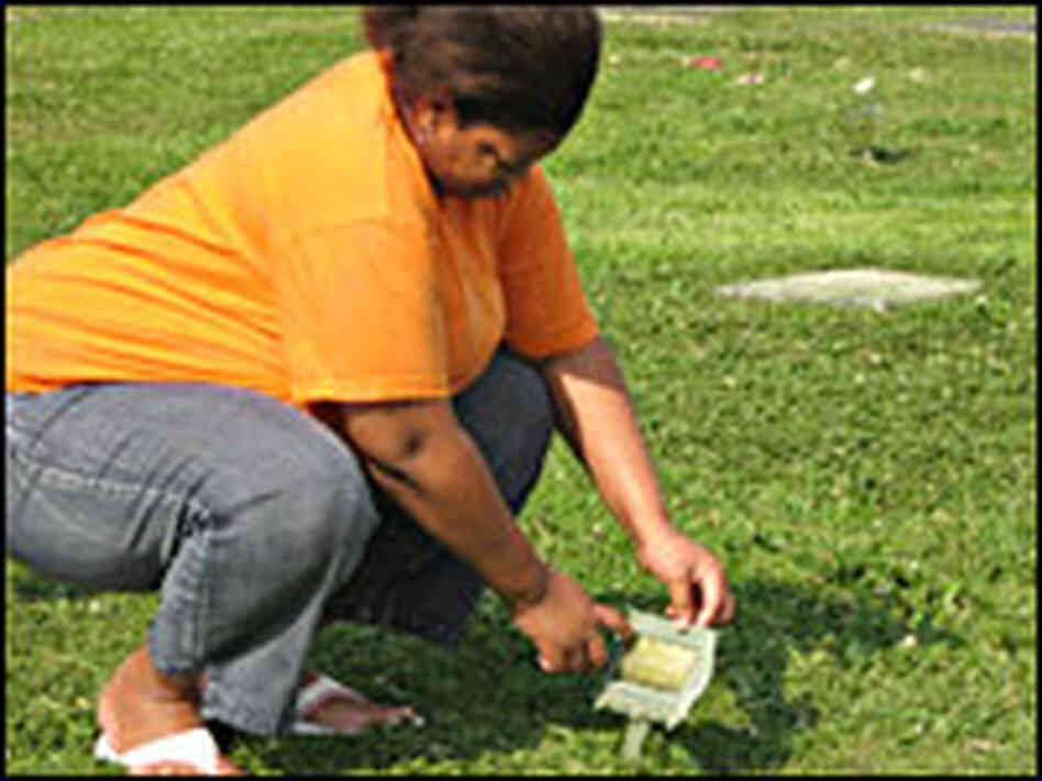 Jamekia Brown at the grave of one of her two deceased babies