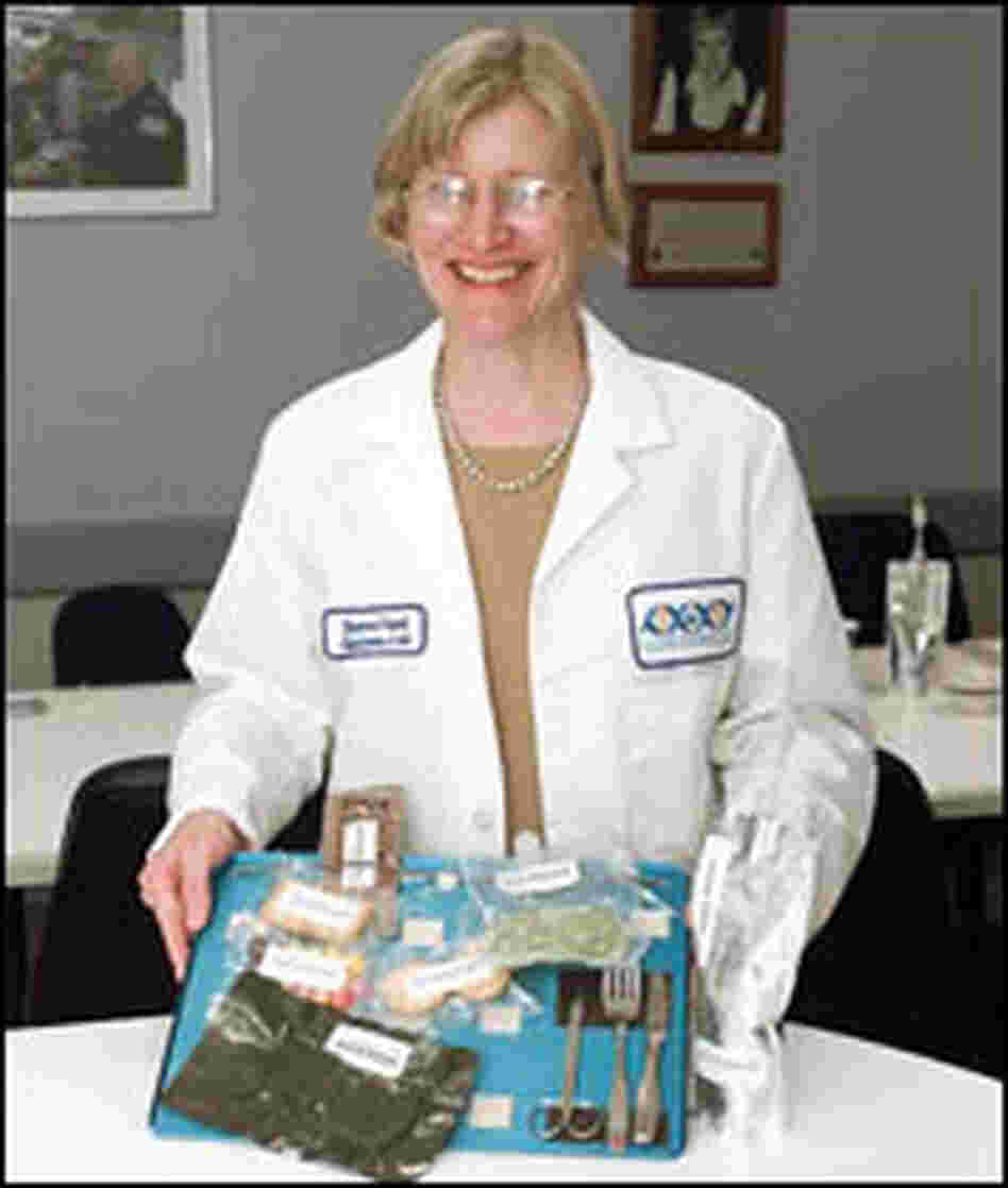 Vickie Kloeris holds a space food tray.