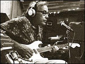 Ry Cooder playing guitar