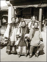 Wealthy Chinese women with bound feet pose for a photo, circa 1900-1920.