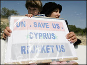 An Iraqi girl holds a placard as Iraqi refugees protest outside the United Nations, Cyprus.
