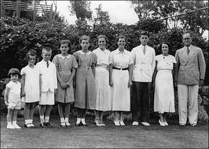 The Kennedy Family stands in a line in a 1937 portrait.