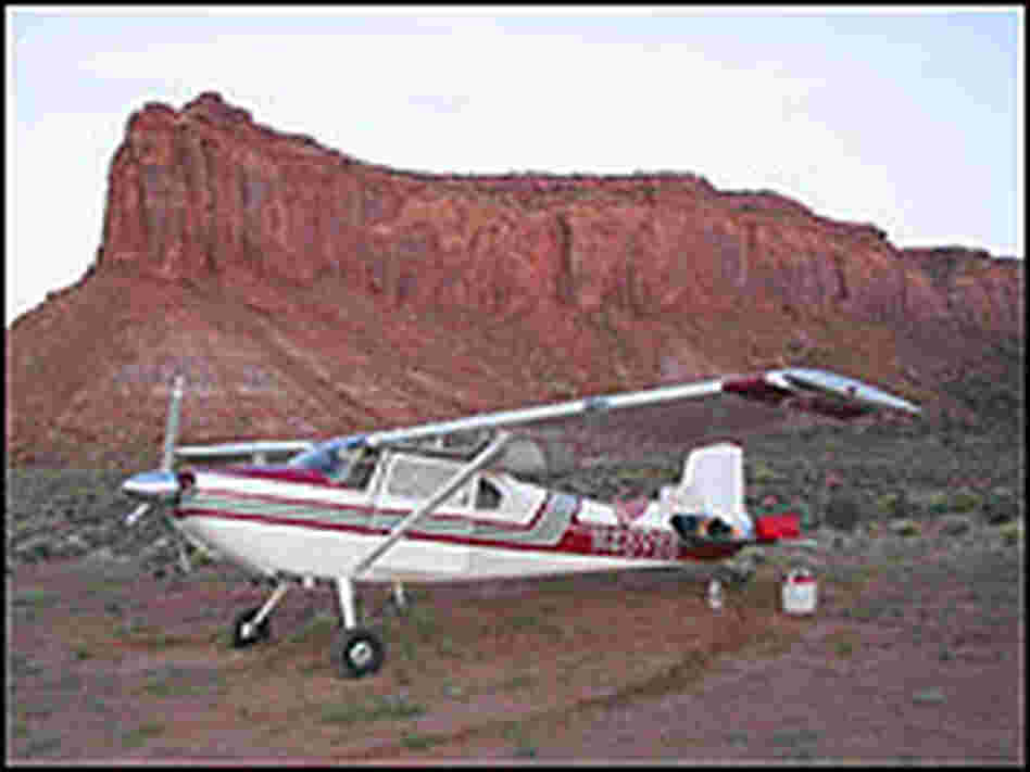Plane parked near butte
