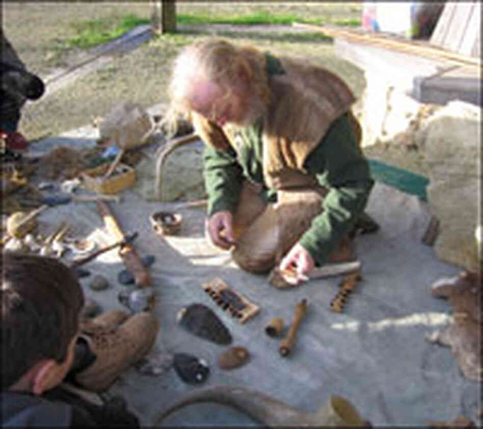 John Lord and the Stone-age tools he has made.