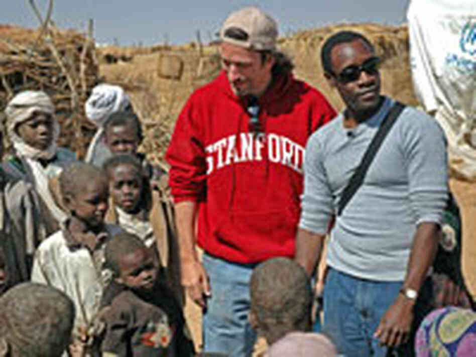 John Prendergast and Don Cheadle visit a refugee camp on the Darfur-Eastern Chad border.