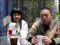 Wu and Wife Sit at Cafe in