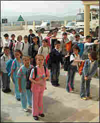Students at the school line up before morning classes.
