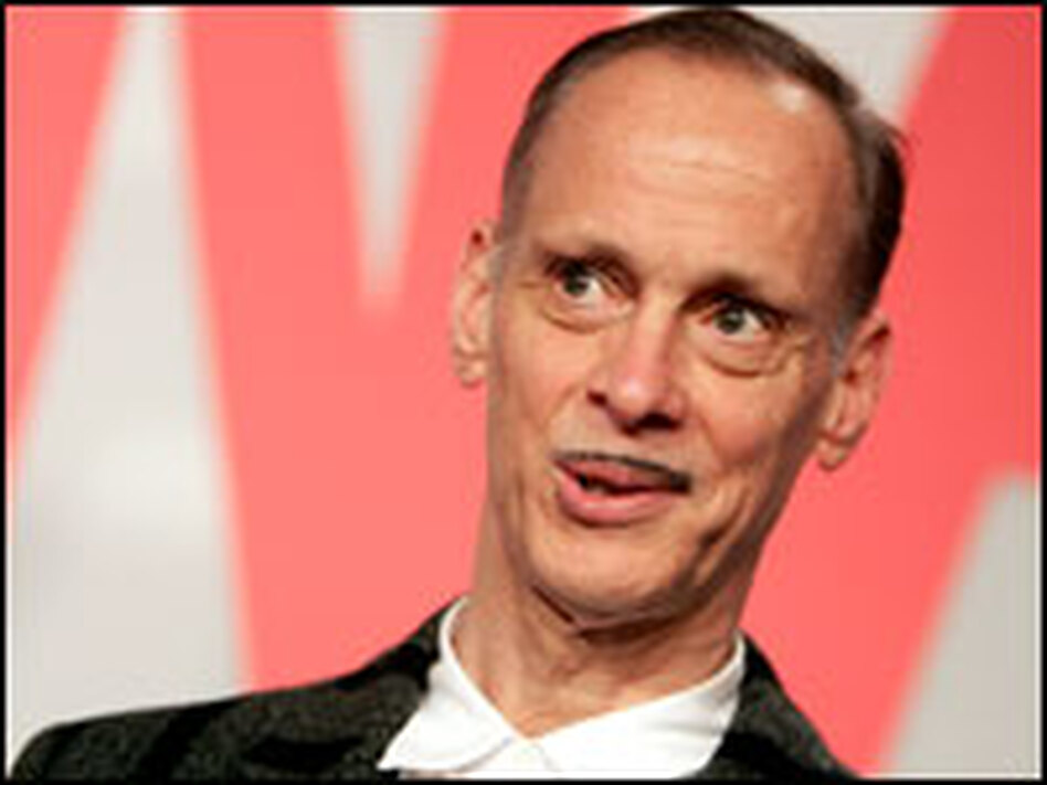 John Waters says he likes all film genres — except romantic comedies.