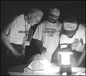 Jimmy Carter and workers oversee vote counting in Liberia.