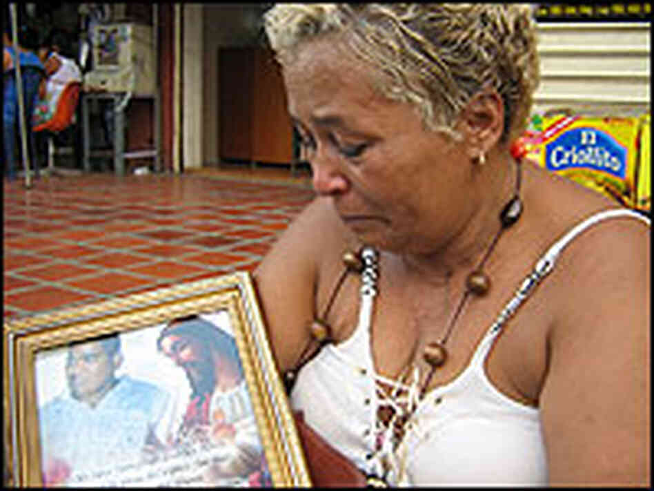 Caraballo holds a picture of her son