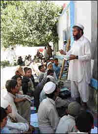 Students listen to their teacher during an Arabic history class.