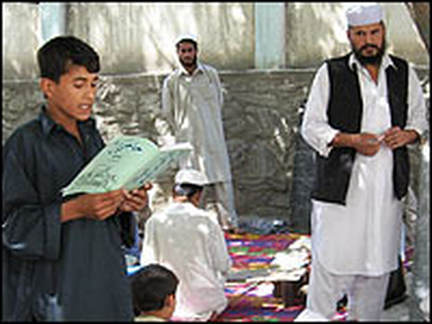 Hajigol, 13, recites from his Pashto reader at the Dar Ulum school in Laghman province.
