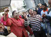 Nozizwe Madlala-Routledge and dances with TAC activists in Cape Town.