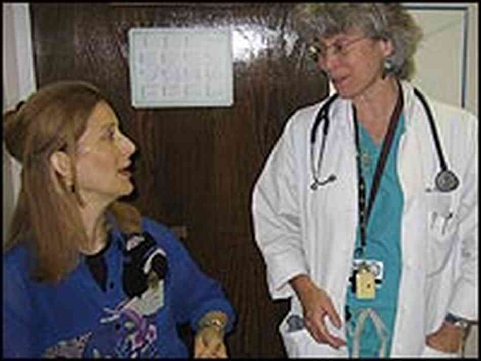 Rosemary Ciotti talks with her doctor, Sandy Caskie.
